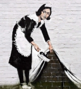 banksy sweeping under the carpet